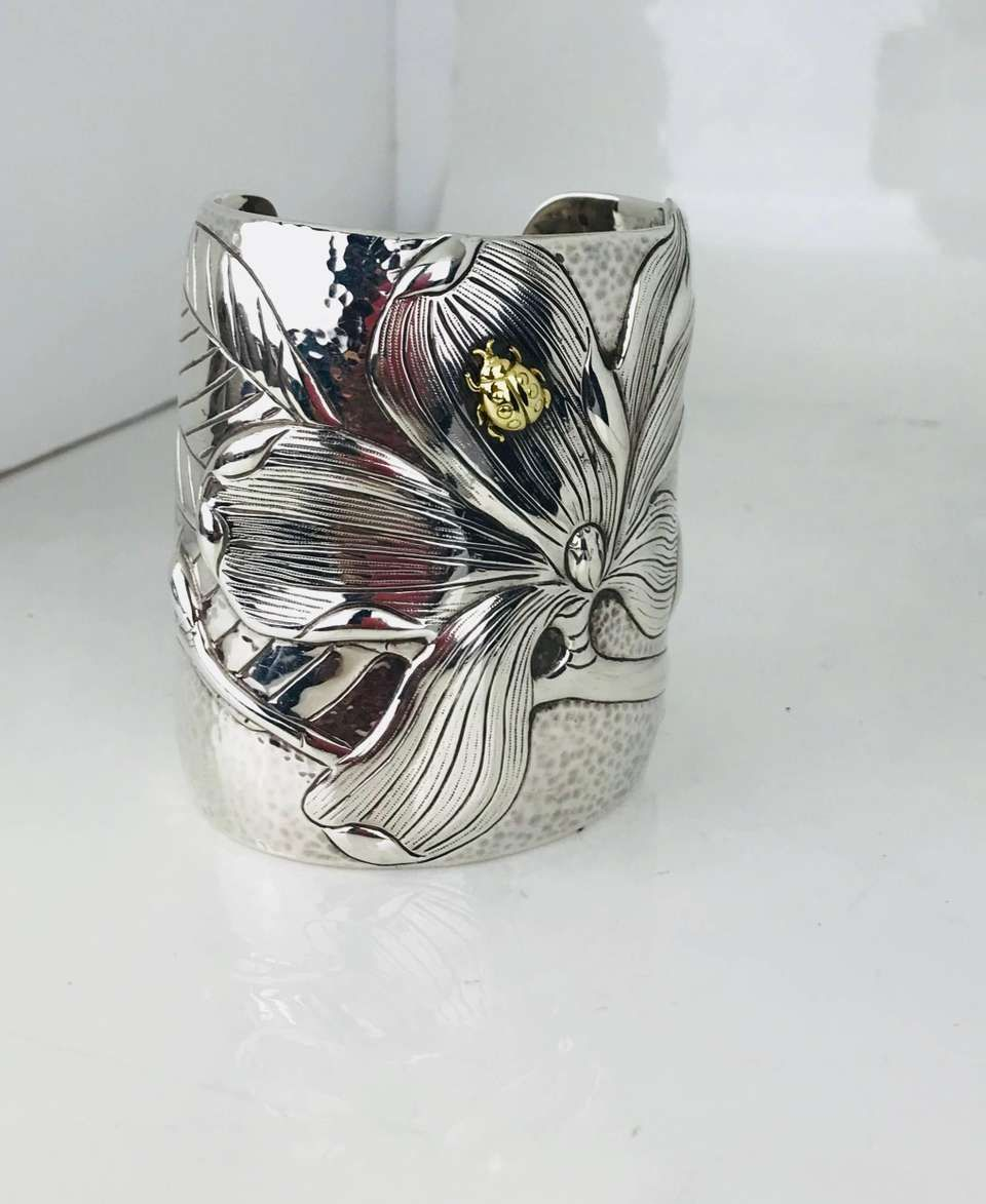 566fdc621 For Sale on 1stdibs - 2001 Tiffany & Co. 925 750 Hand Hammered Magnolia  Lady Bug Cuff Bracelet Vintage, Retired, & Extremely Rare Sterling Silver  Repousse ...