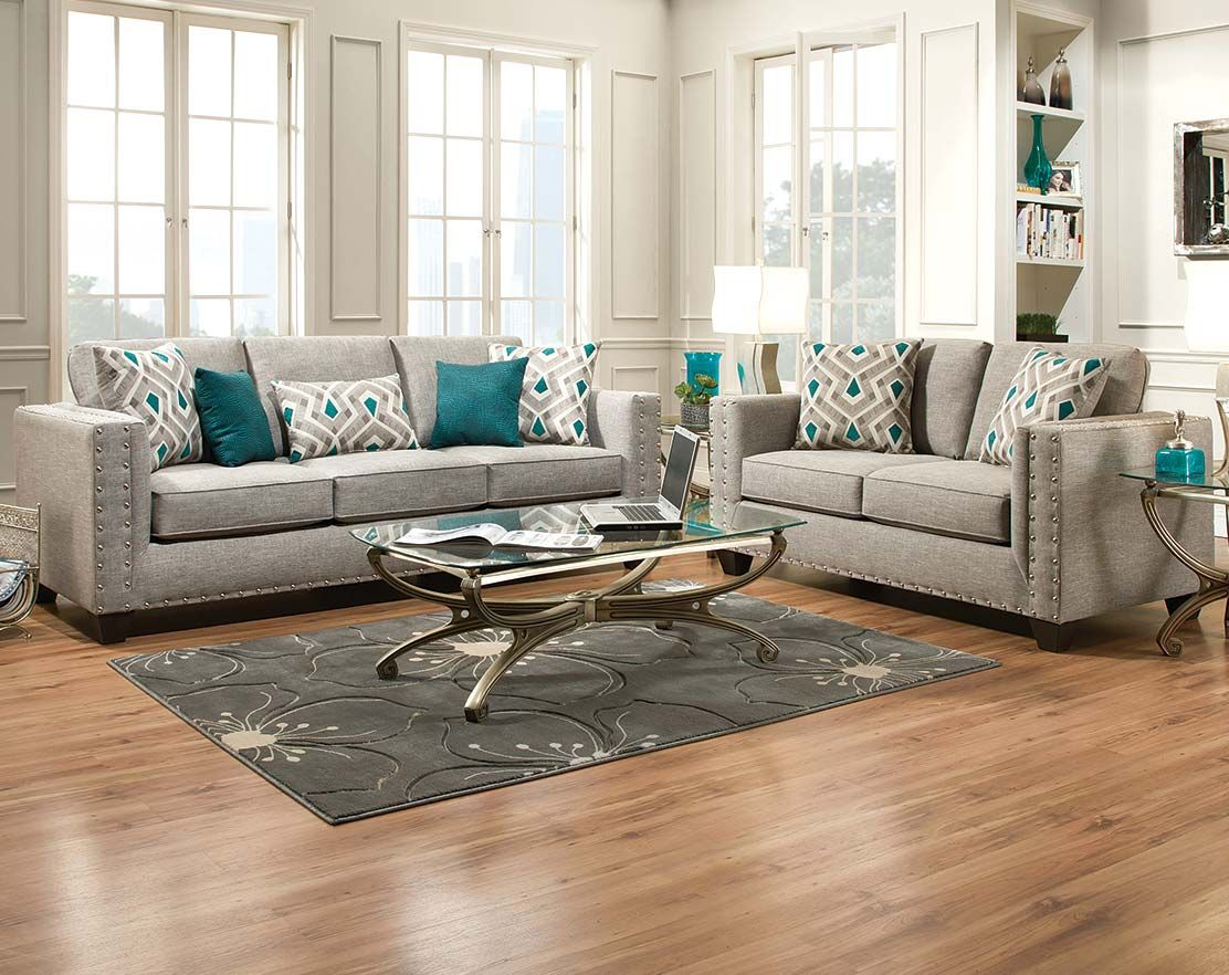 silver glass living room furniture%0A The Paradigm Quartz Sofa and Loveseat is a beautiful light gray set   uniquely detailed with silver stubs on the armrests  with teal throw  pillows