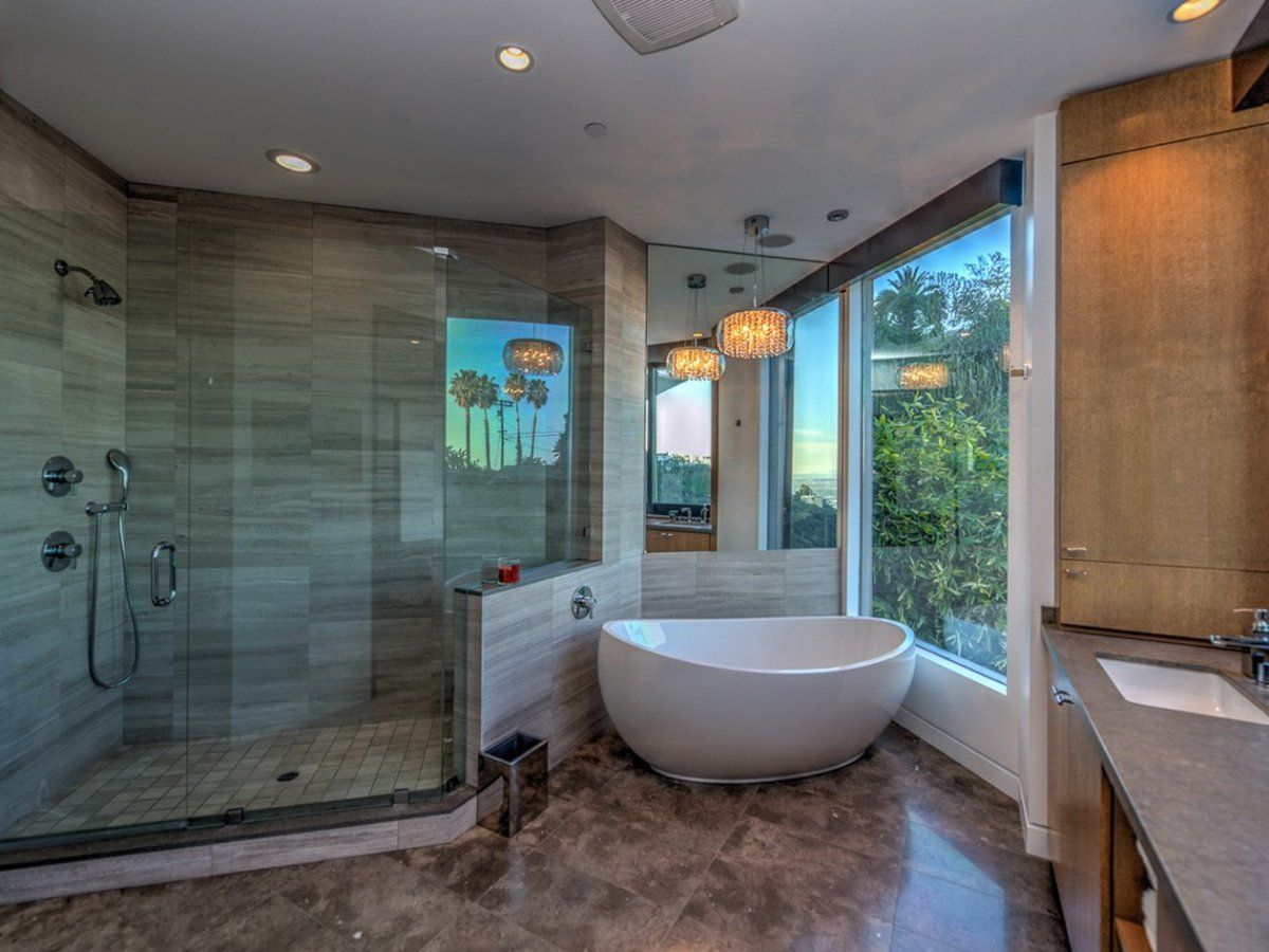 the-master-bath-has-a-standalone-tub-and-a-large-shower | Homes ...