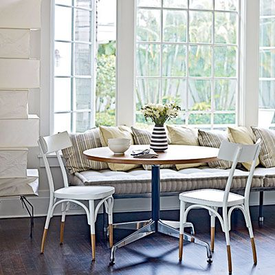 In this Vero Beach, Florida, home designer and architect Russell Groves painted most rooms neutral shades, and stained the existing hardwood floors a contrasting dark brown.   Coastalliving.com