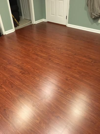 Finished Floor In Basement You Need A Moisture Barrier And Padding When Installing On A Concrete Subfloor Below Flooring Laminate Flooring Laminate