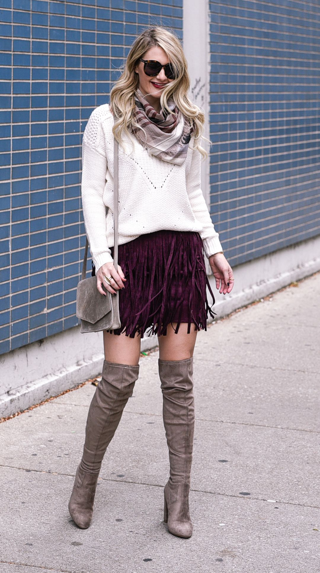 a50361eb7fa Jenna Colgrove wearing suede over the knee boots, a white knit sweater, and  a burgundy fringe skir.t