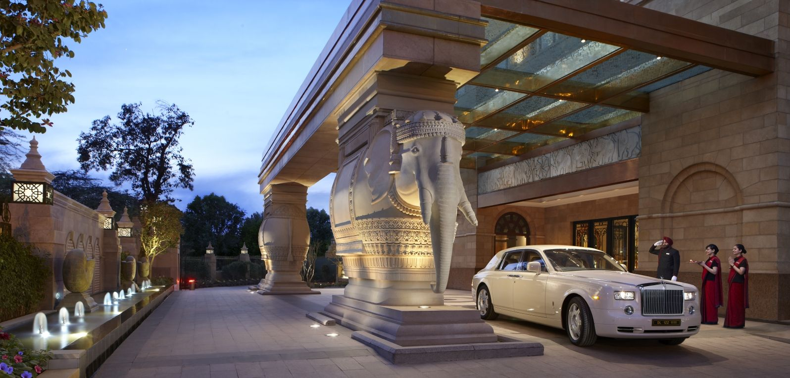 Arrive In Style At The Grand Porte Cochere Of The Leela Palace New Delhi Statues Of Two White