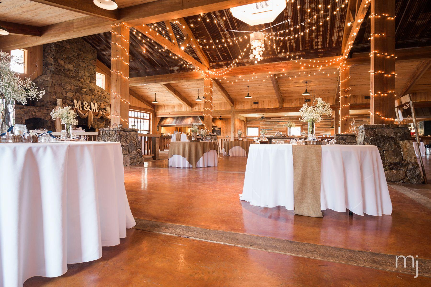 Informal reception setting rustic barn wedding with