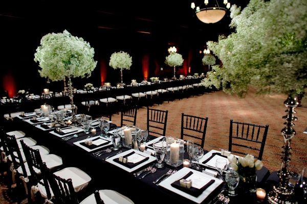 Black tablecloths with white candle wedding centerpiece decor, photo by John and Joseph Photography #whitecandleswedding