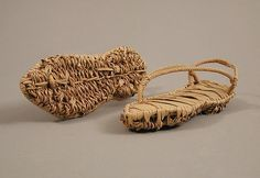 Pair of Sandals  4th–7th century Geography: Made in Kharga Oasis, Byzantine Egypt Culture: Coptic Medium: Palm leaf with the inner sole made of strips, the lower sole in basket weave, and the straps plaited Dimensions: Overall: 1 5/8 x 2 1/16 x 5 3/8in. (4.2 x 5.3 x 13.6cm) a: 1 5/8 x 2 1/16 x 5 3/8in. (4.2 x 5.3 x 13.6cm) b: 1 9/16 x 2 1/16 x 5 3/16in. (4 x 5.3 x 13.2cm) Classification: Miscellaneous Credit Line: Rogers Fund, 1931