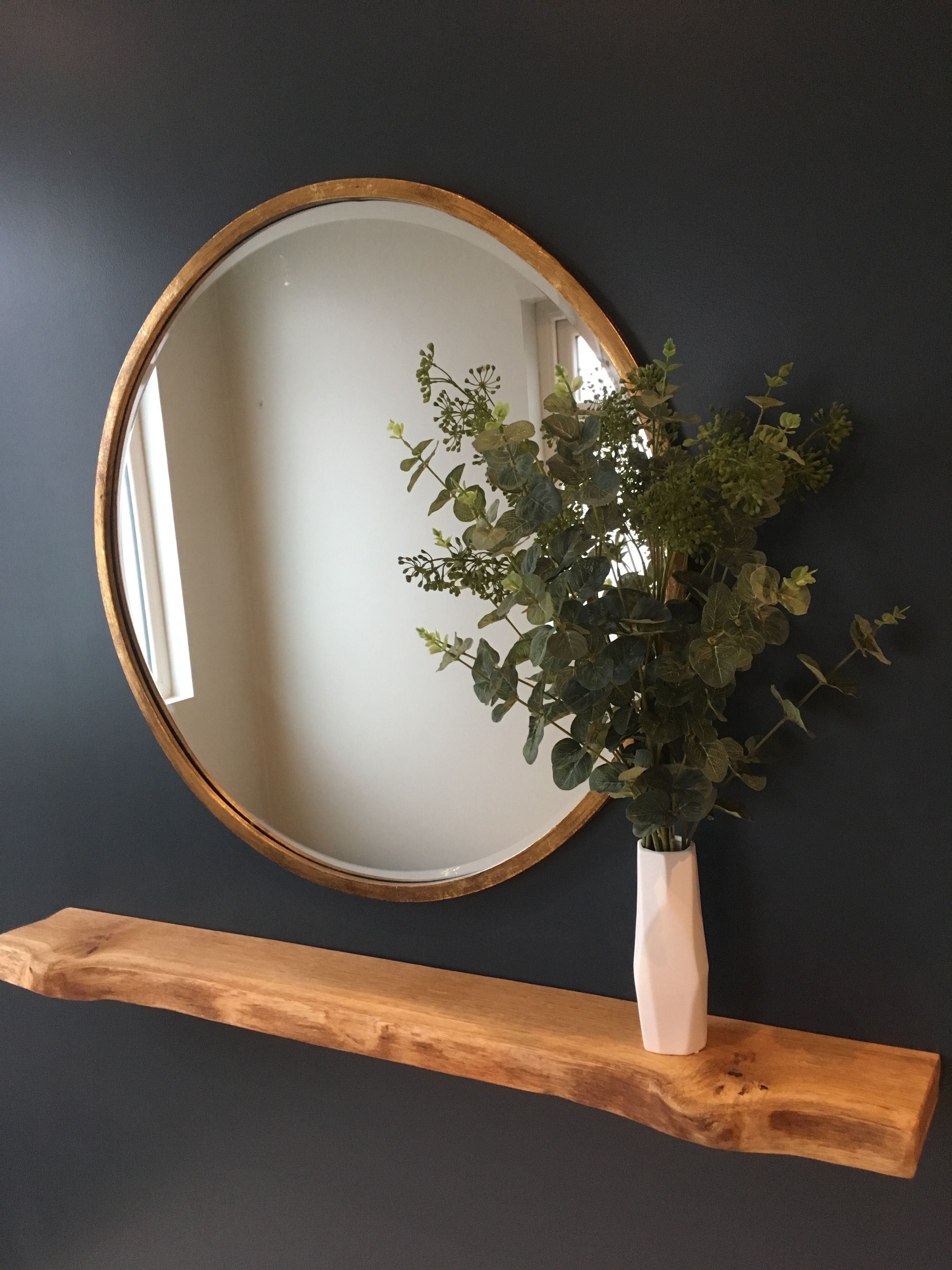 Bronze Round Mirror With Eucalyptus Leaves And A Floating Oak Shelf Hallway Inspiration Navy Hallway Decor Hallway Decorating Home Decor
