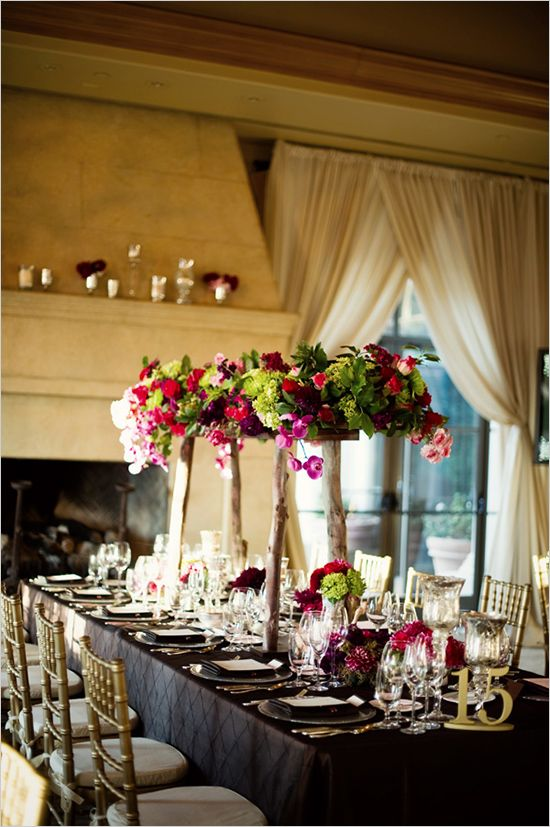 Beautiful, lush pink flowers, manzanita, and pops of green... Adds height in a lofty ballroom