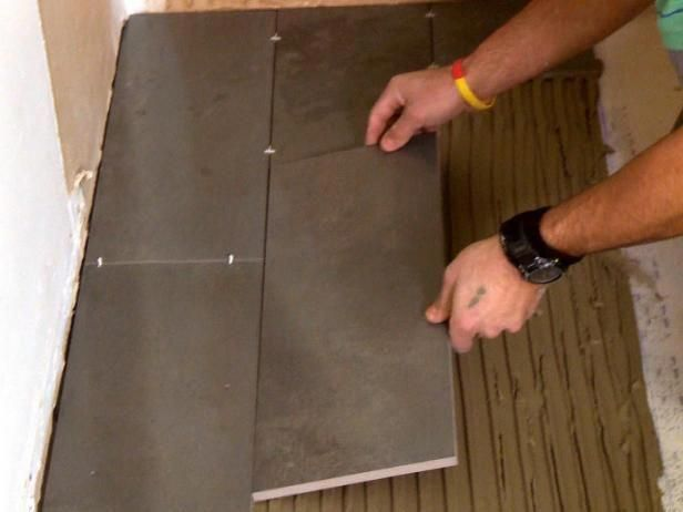 Laying Plank Floor Tiles Over Mortar Mix On Ground In This