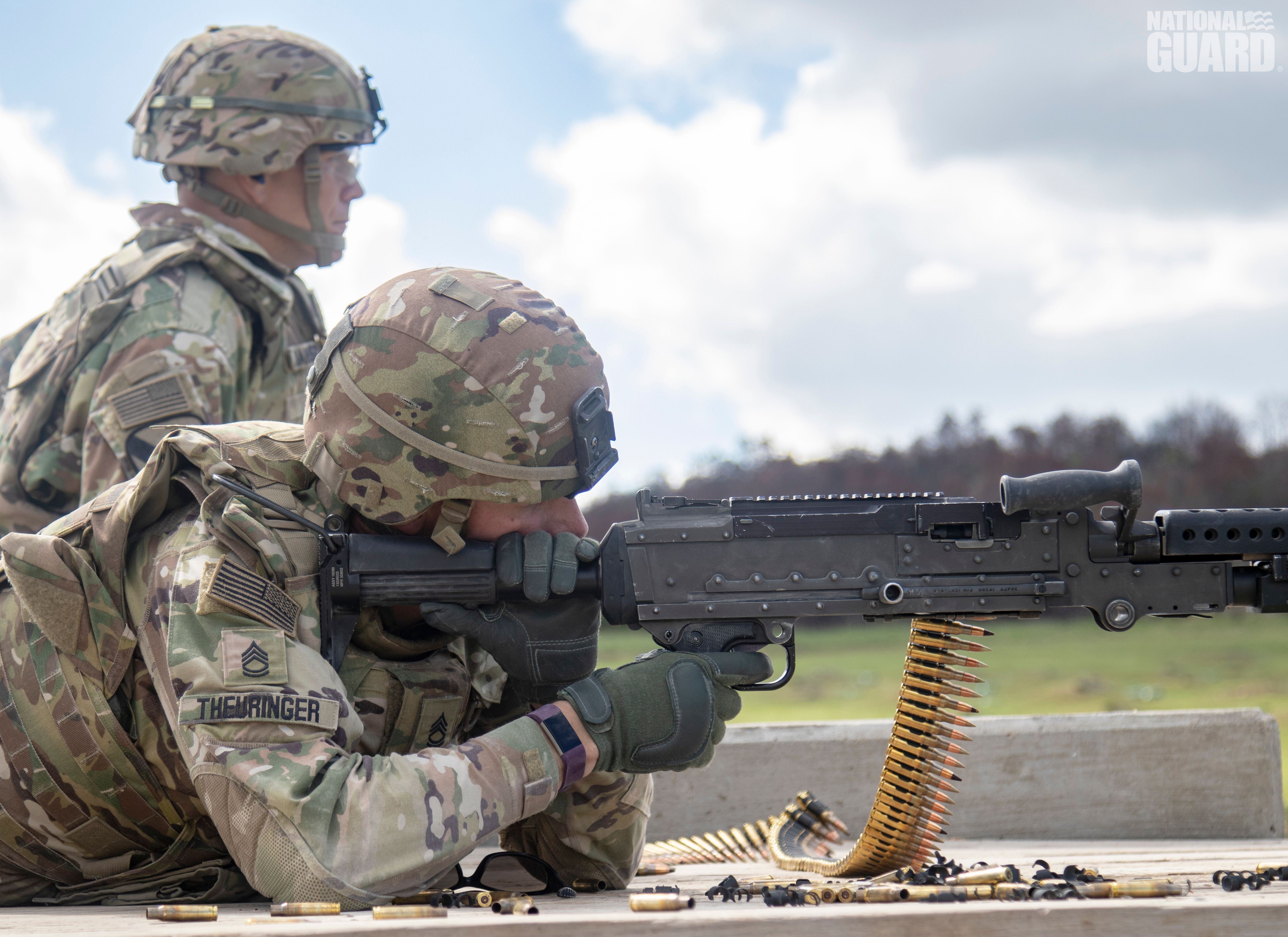 Soldiers take up a good prone firing position to qualify on