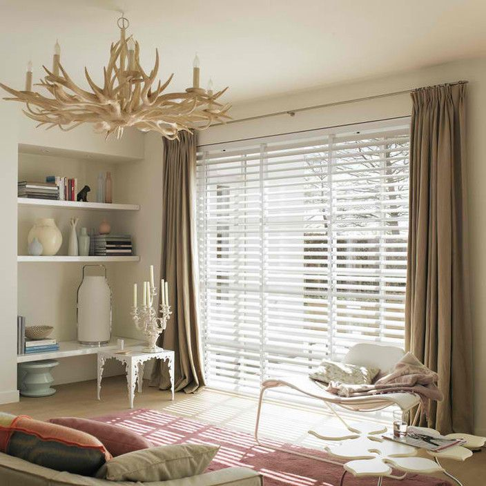 Internal white venetian blinds with blockout curtain over
