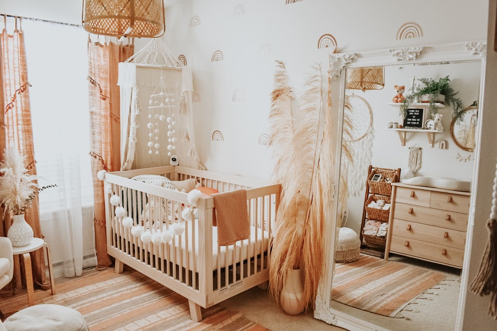 Photo of Boho Baby Nursery with Muted Rainbow Wall Decals