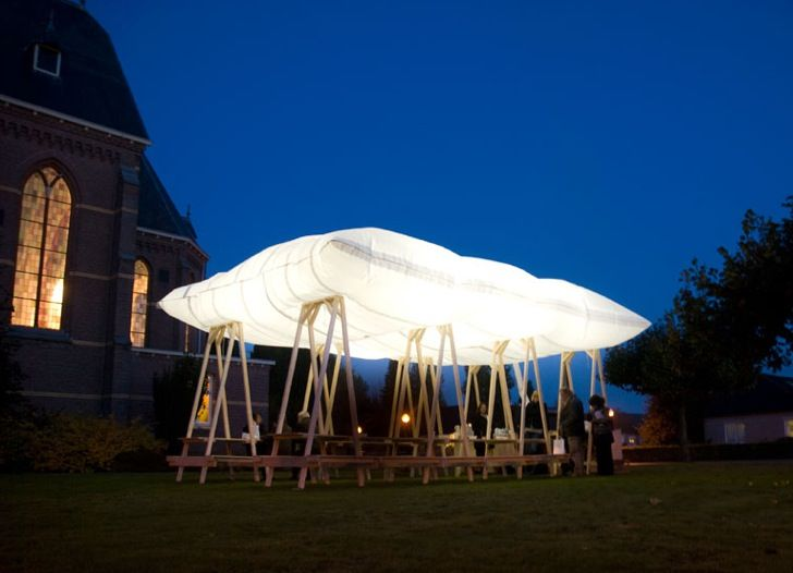 An All Soul's Day temporary pavilion features a hovering fabric roof that fills up with smoke.