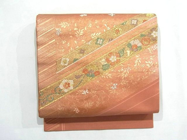 This is a gorgeous Nagoya obi with a design of vibrant 'Karabana' (imaginary flower in China) on diagonal stripe pattern, which is woven
