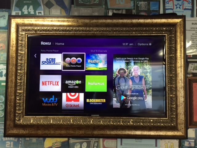 A flat screen TV can be framed to match and enhance your home decor!