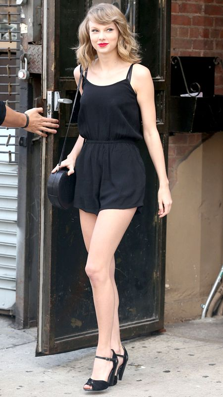 24 Reasons Why Taylor Swift Is a Street Style Pro -  JUNE 14, 2014 The singer stepped out in New York City post-workout wearing a simple MinkPink crepe romper. She paired the summer-ready piece with a black circle bag, strappy peeptoe heels, and her signature bold red lip.