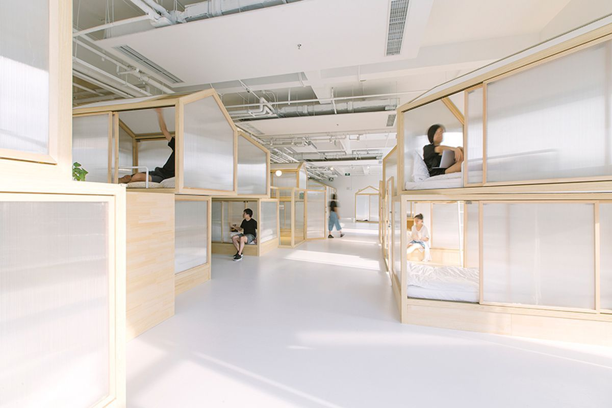 Minimalist tiny houses fill up modern beijing hostel concept
