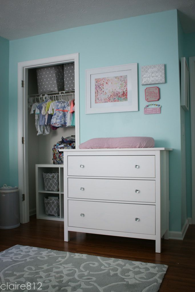 A Chandelier Filled Tiffany Blue Nursery With Mive Amounts Of Storage