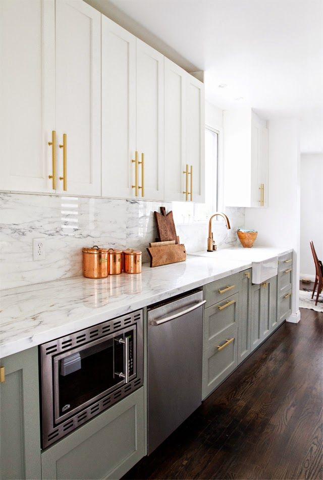 Kitchen With Gray Lower Cabinets And White Uppers With Brass Hardware And Marble Countertops Kitchen Inspirations Clutter Free Kitchen Kitchen Trends