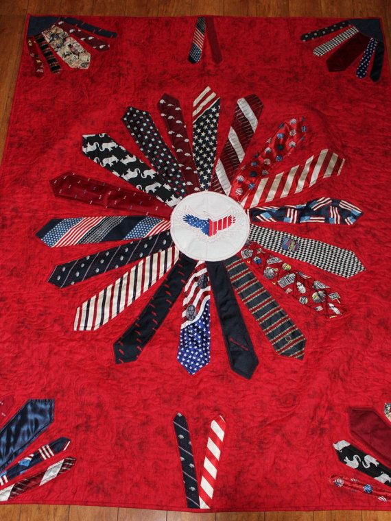 This memory quilt was made for a daughter from her father's ties. He had been a state senator and so she wanted a neck tie quilt made from all the patriotic ties he used to wear. We decided on this Starburst look with a circle in the center. The circle was embroidered with an American eagle. This is just another example of how neck ties can be used on a quilt. It can be done with any color you like and with anything put in the center like perhaps his Monogram.  These quilts are such a great…