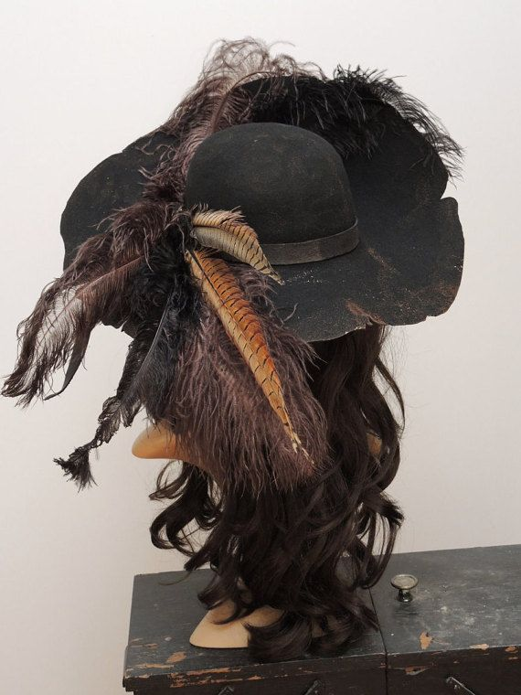 df4010ee53414 ... hat + + + The hat is made of aged premium woolfelt. It is adorned with  feathers of pheasants and ostriches