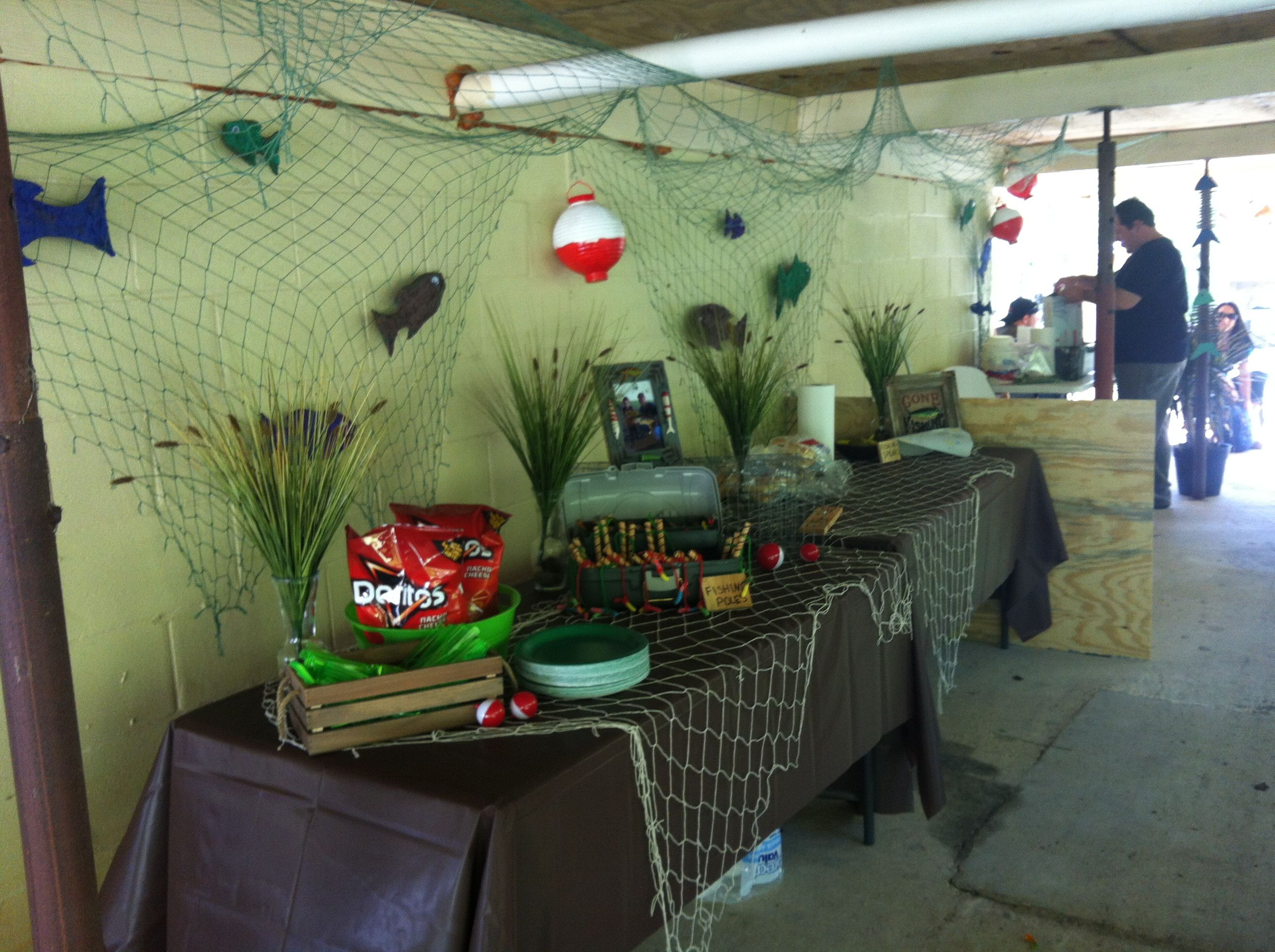 My sons third birthday party gone fishing fish net for Fish net decoration ideas