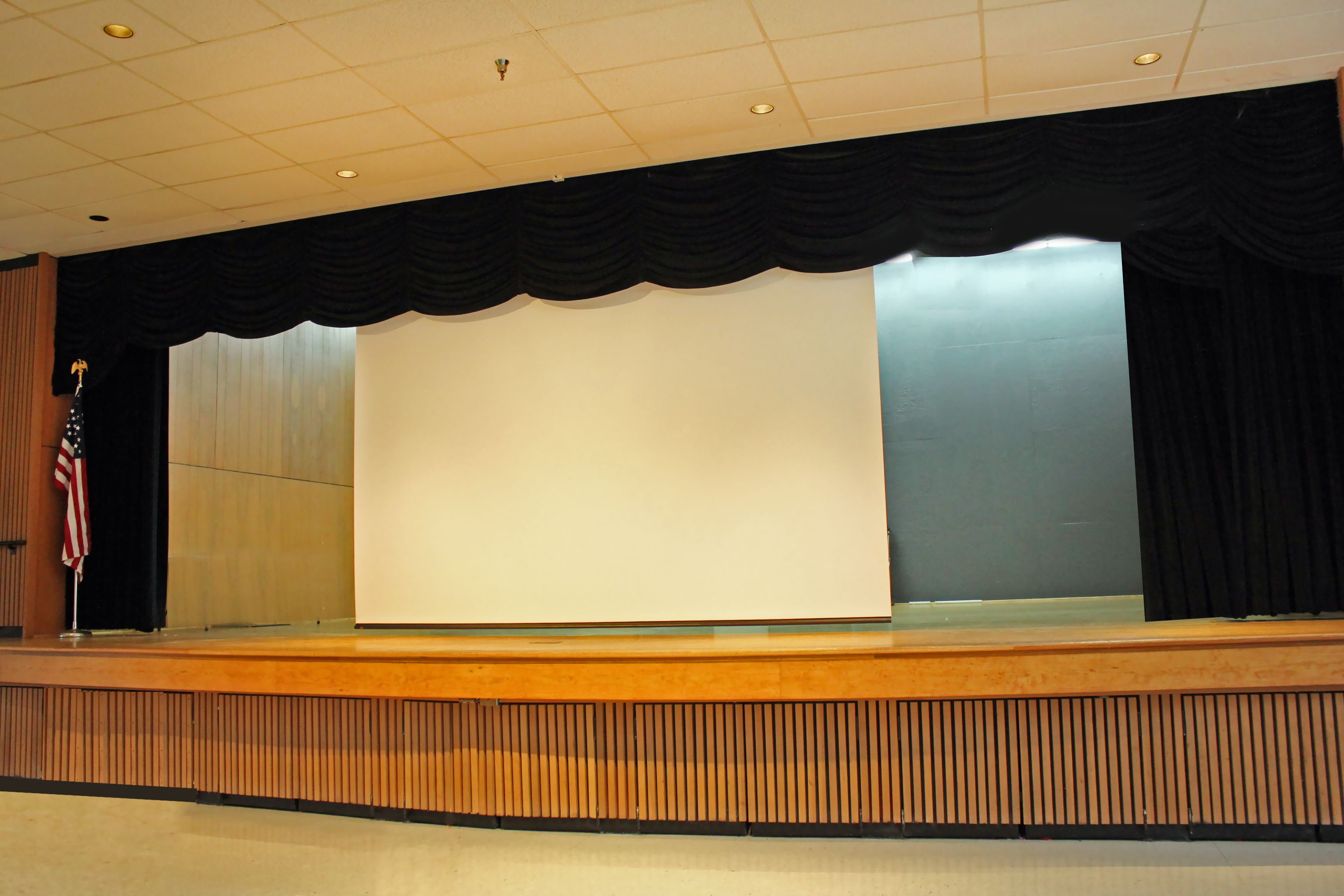The Civic Center Ballroom Has A Full Stage With Curtains Lighting