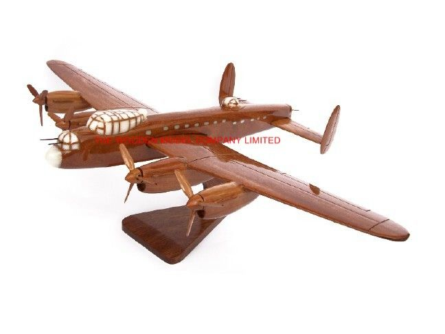"A beautiful hand carved desktop model of the Lancaster Bomber. The model has been carved from solid mahogany. The model comes boxed and is simple to assemble. The wings, stand and rota simply slot into pre-drilled holes on the body of the aircraft. No glue required. Size H 7"", L 15"", W 21"". Visit our website at http://www.thewoodenmodelcompany.co.uk to view our range of models"