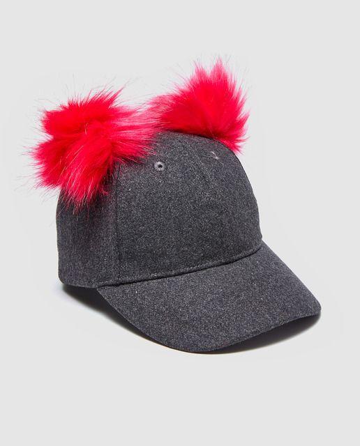 Gorra de niña Freestyle negra con dos pompones rosas  3786ea80c4a
