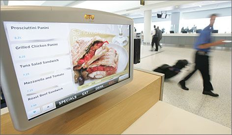 """Convenience on the menu: Terminal 5's """"re:vive"""" food service concept features seating clusters with touch-screen monitors that promise to he..."""