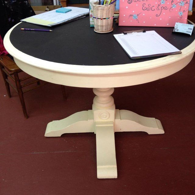 The top of this table is painted with chalkboard paint, yes you can write on it. I am using this in my studio, hence the low price! I do not have any chairs, this is for the table only. It is a round kitchen table, solid wood and very nice!