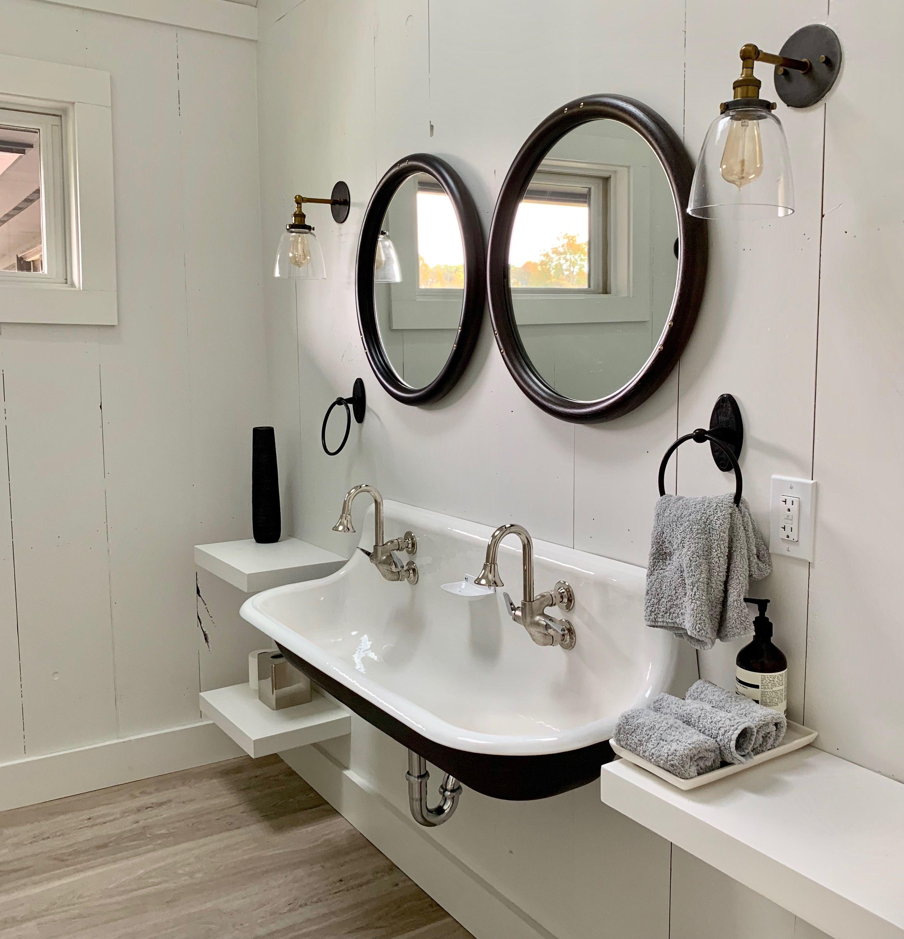 Modern Farmhouse Bathroom With Trough Sinks Painted Black On The Underside Small Bathroom Trends Matte Black Bathroom Faucet Traditional Bathroom Sinks