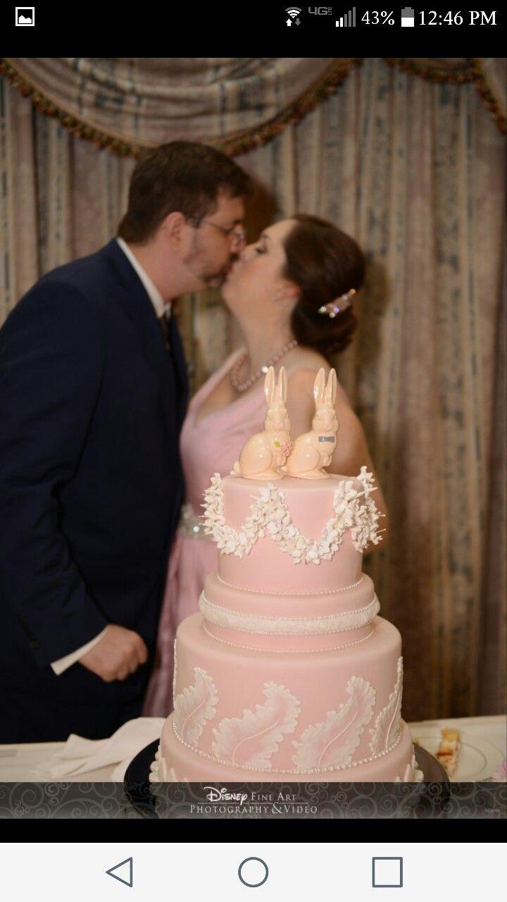 Pink wedgewood wedding cake with bunny topper