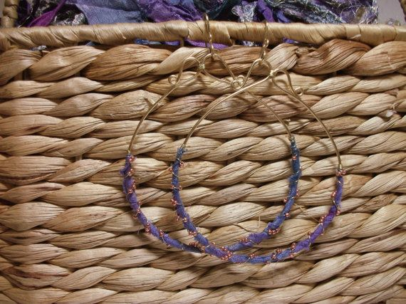 Check out this item in my Etsy shop https://www.etsy.com/listing/216551832/fairtrade-sari-silk-wrapped-brass-hoops