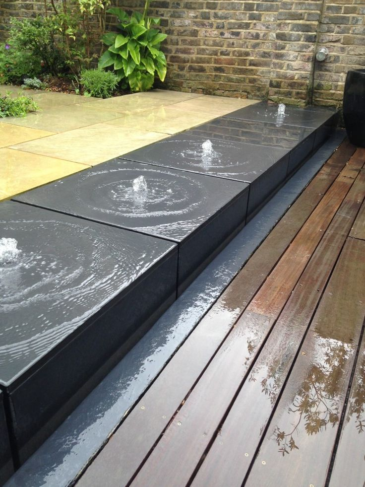 A series of Bubble fountain blocks makes for a striking ... on Modern Backyard Water Feature id=28412