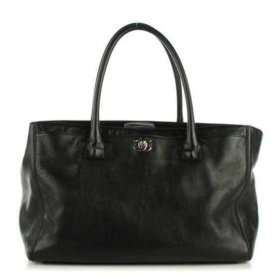 This is an authentic CHANEL Calfskin Cerf Executive Shopper Tote in Black. This is a classic shopper tote that is simple yet sophisticated and chic.