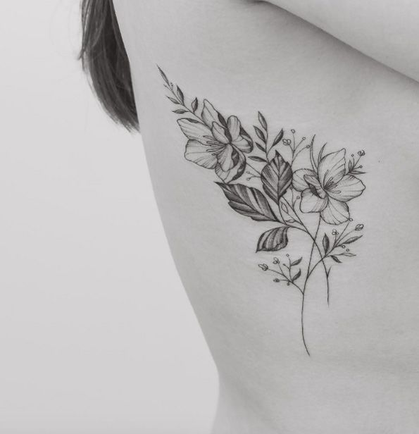 Rib Cage Flower Tattoo: 60 Must-See Tattoos For Woman Considering Ink