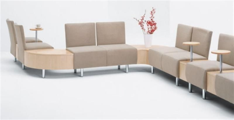 Modern Interior Design With A Long Beige Sofa Office Furniture Chairs Waiting Room Ideas