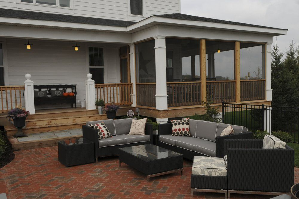 Biota Landscape Design installed a brick and bluestone outdoor room with a firepit..