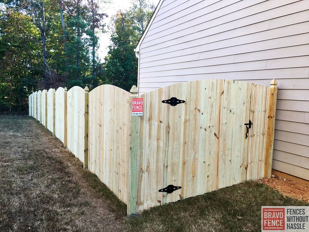 Arched Wooden Privacy Fence Our privacy fences not only provide you with the security you need, but can also be customized in different ways! Featured Fence: 6' Arched Privacy with French Gothic Posts