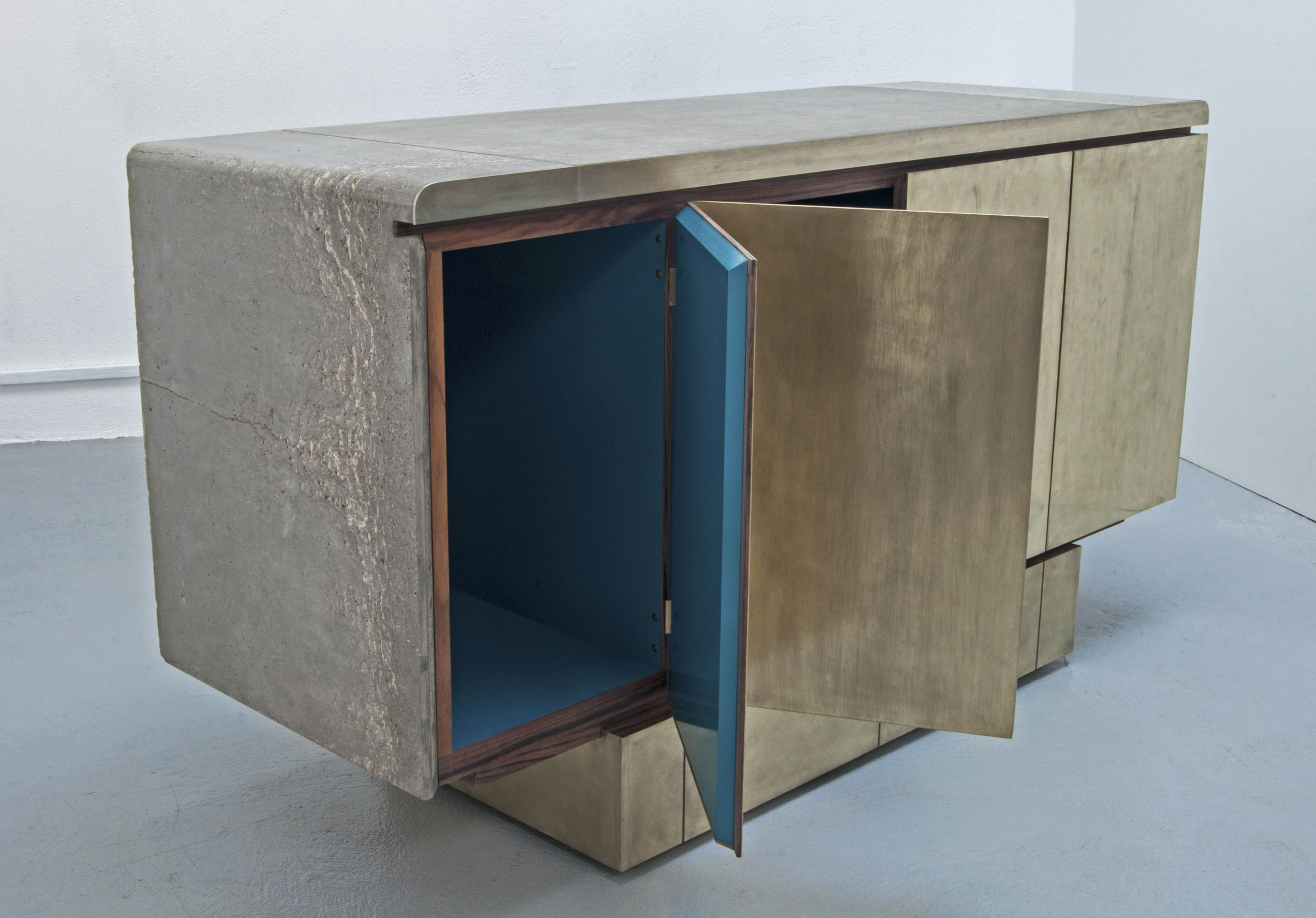 New Cabinet (small version) with cast concrete top and side L sections, over vibrated to create errors giving great pattern and texture. Scratched brass front with brush painted high gloss interior and rosewood detailing.