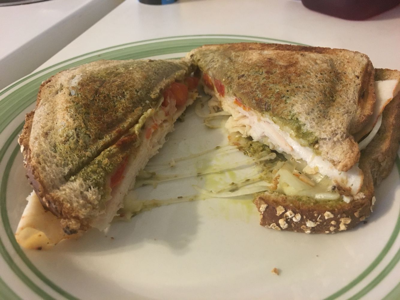 Pesto chicken and tomato sandwich