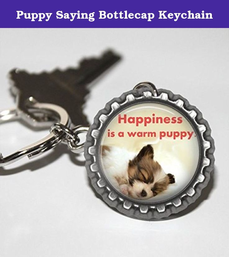 Puppy Saying Bottlecap Keychain. Puppy saying bottlecap keychain is made with a flattened bottlecap high quality photo paper and an epoxy dome. This key chain is great for Dog lovers. Bottlecap is attached to a 25mm key ring. This keychain says Happiness Is A Warm Puppy on it.