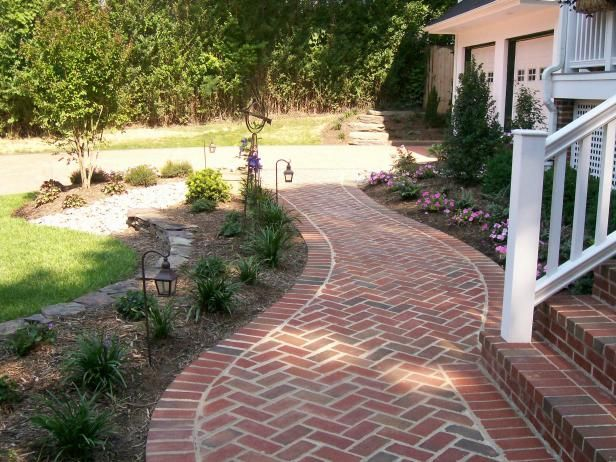 Curved Brick Walkway With Landscaped Garden Beds Sidewalk Landscaping Walkway Landscaping Brick Walkway