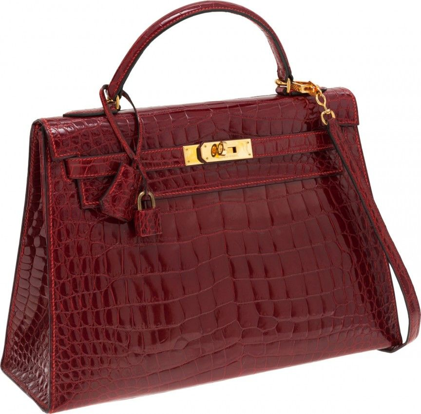 3ff968d95059 The Hermes Red Crocodile Birkin Purse Bag measures only 11 inches. It holds  the world record as the most expensive purse sold at an auction.