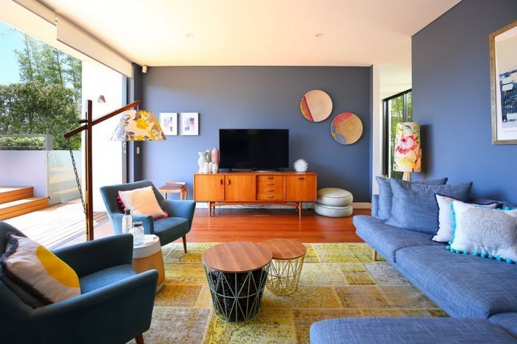 Living Room With Blue Sofa Chairs Wooden Cabinet Flower Cap Floor Lamp Tv Warm Ye Blue And Orange Living Room Grey And Orange Living Room Blue Living Room