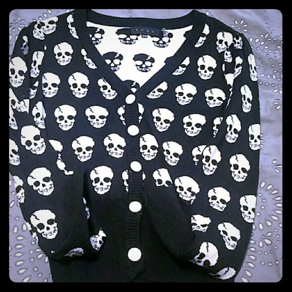 Modcloth Skulls in Session Cardigan. Super cute size s/m modcloth skull cardigan. Very edgy and never worn. Is a shorter cardigan. I also have it in the same size in the color burnt sienna if interested. Please ask questions and will model on request :) ModCloth Sweaters Cardigans