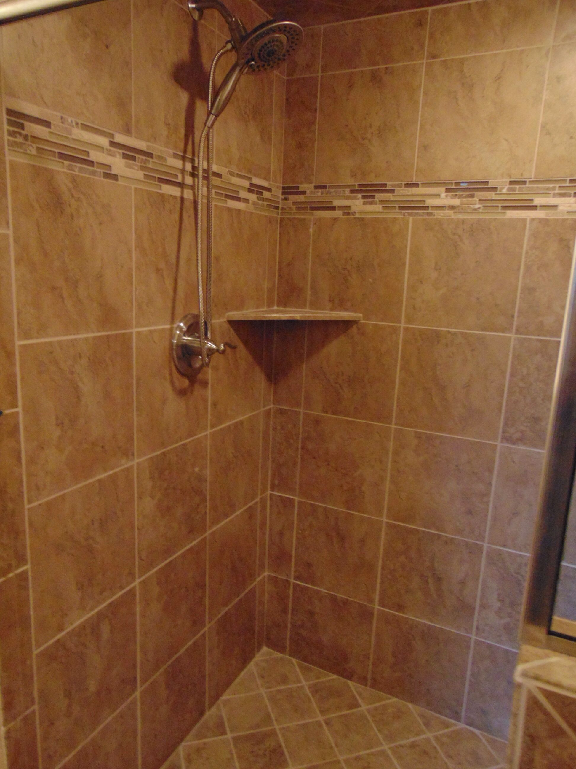resort style walk in tile shower with bench seat hand held sprayer