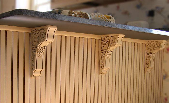 wood brackets with carved grape design under kitchen counter - #corbels #brackets #woodbrackets