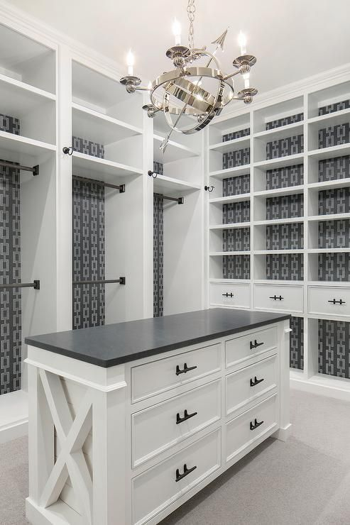 Well Appointed White And Gray Walk In Closet Features A Visual Comfort Armillary 6 Light Chan Bedroom Organization Closet Master Closet Design Closet Built Ins